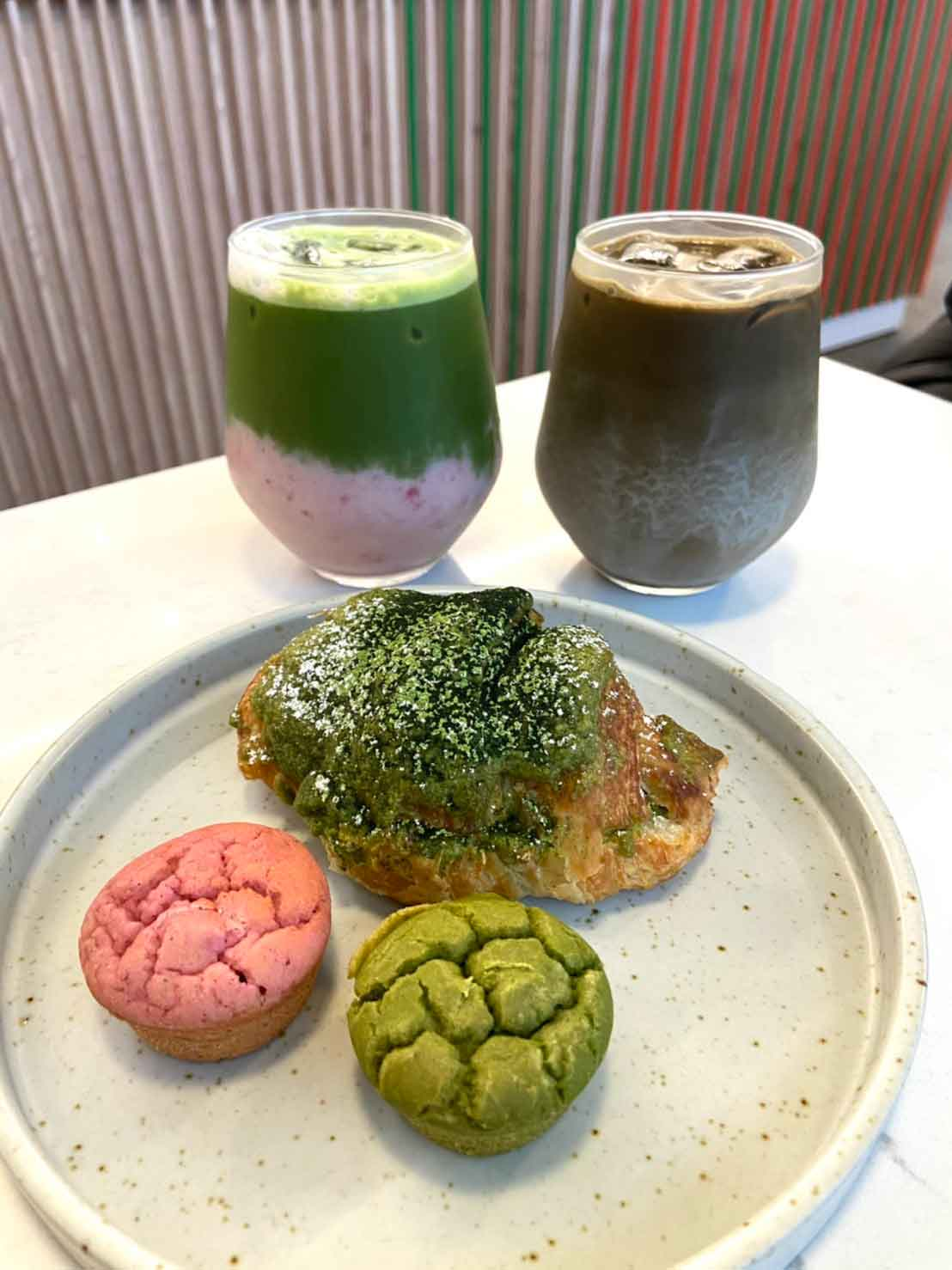 Iced Strawberry Matcha Latte, Iced Hojicha latte, Matcha croissant, Strawberry and Matcha mochi muffin
